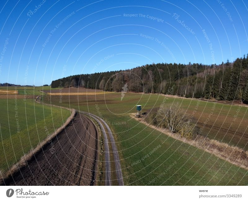 Aerial view of a dirt road between fields Umwelt Natur Feld groß Unendlichkeit Stadt Area flight aerial view bird's eye view copter country countryside