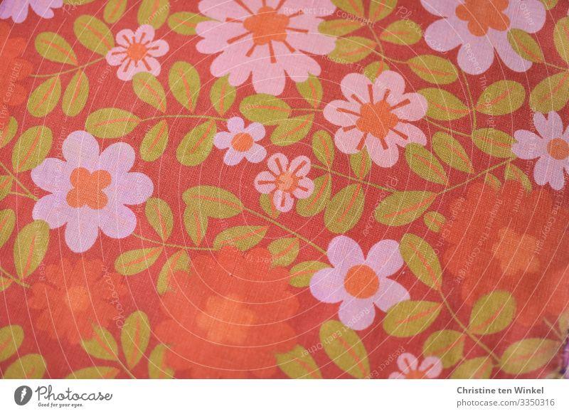 Stoff mit Blüten in orange, pink und grün. 70er Jahre Baumwolle Zeichen Blumenmuster authentisch Freundlichkeit Fröhlichkeit trendy Kitsch retro verrückt schön