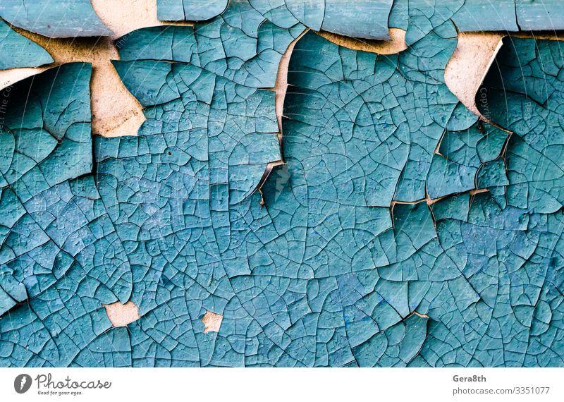 Wandtextur mit rissig abblätternder blauer Farbe Beton alt dreckig retro blanko Betonmauer Riss Schaden Grunge rau schäbig Oberfläche Konsistenz altehrwürdig