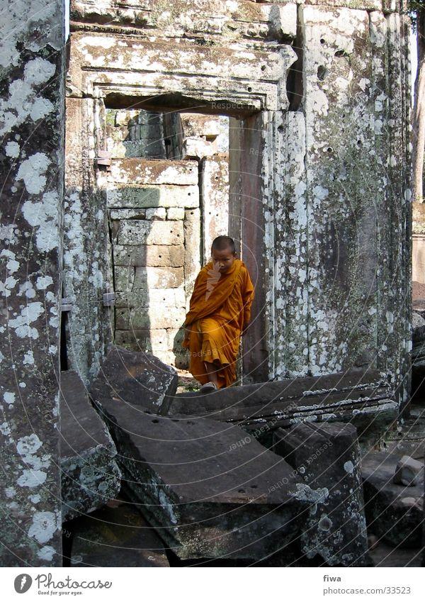 Mönchsjunge in Ankor Kind Ruine ruhig Mann Junge orange Buddismus