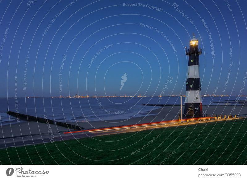 Leucht Turm Strand Meer Architektur Umwelt Natur Luft Wasser Himmel Wolkenloser Himmel Klima Gras Wellen Küste Nordsee Leuchtturm Bauwerk Sand Gefühle Stimmung