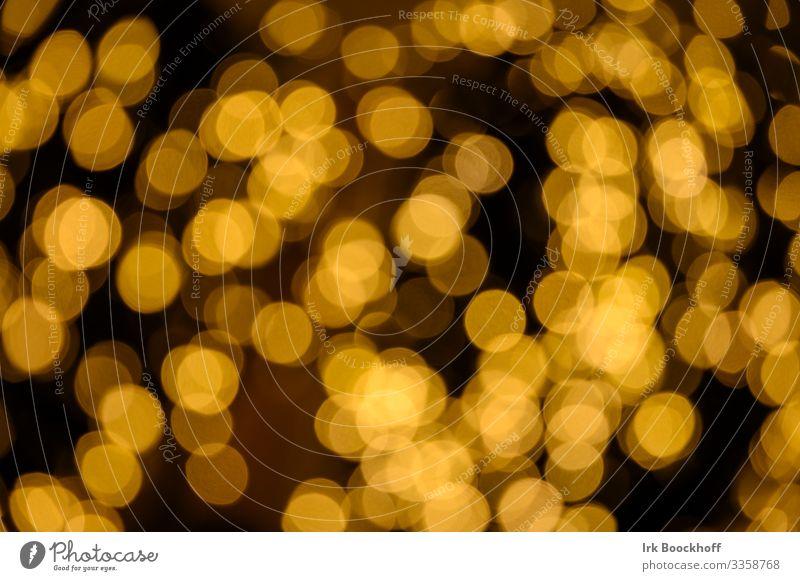 unscharfe Lichtreflexe zur Weihnachtszeit Kunst Lichter glänzend leuchten ästhetisch gelb Freude Warmherzigkeit Energie Idee Reflexion & Spiegelung Farbfoto