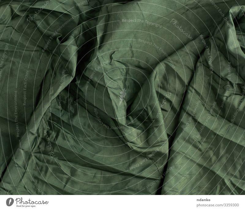 grüner Satin-Textilstoff Reichtum elegant Design Mode Stoff glänzend dunkel weich Farbe Material Hintergrund Leinwand Sahne zerknittert Gardine Kurve filigran