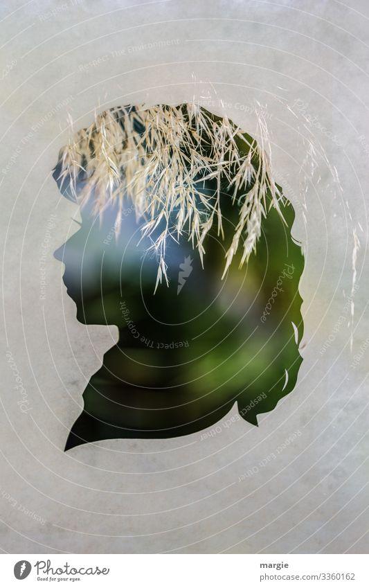 Profil einer Frau als Scherenschnitt mit Gräsern als Kopfschmuck Gras Doppelbelichtung Heu Licht Silhouette kreativ grün Natur Papier papierschnitt Gesicht