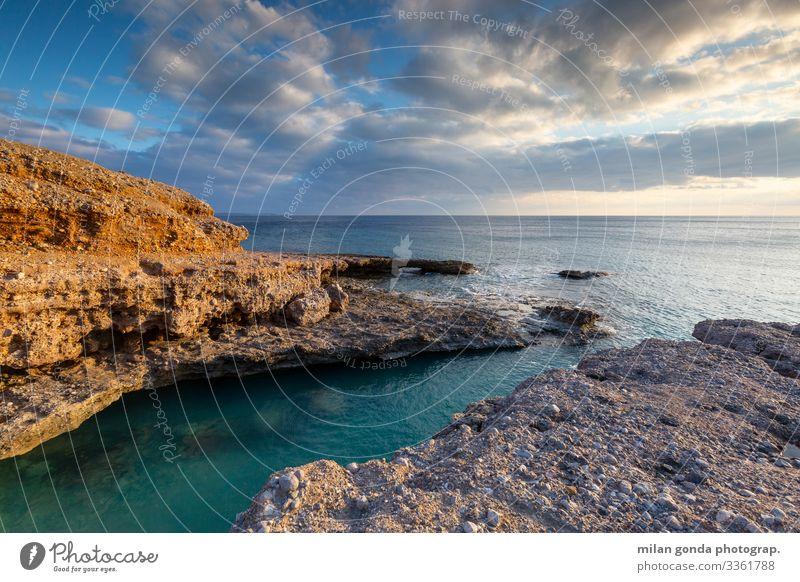 Natur blau Meer Küste orange Europa Griechenland Klippe Felsbogen