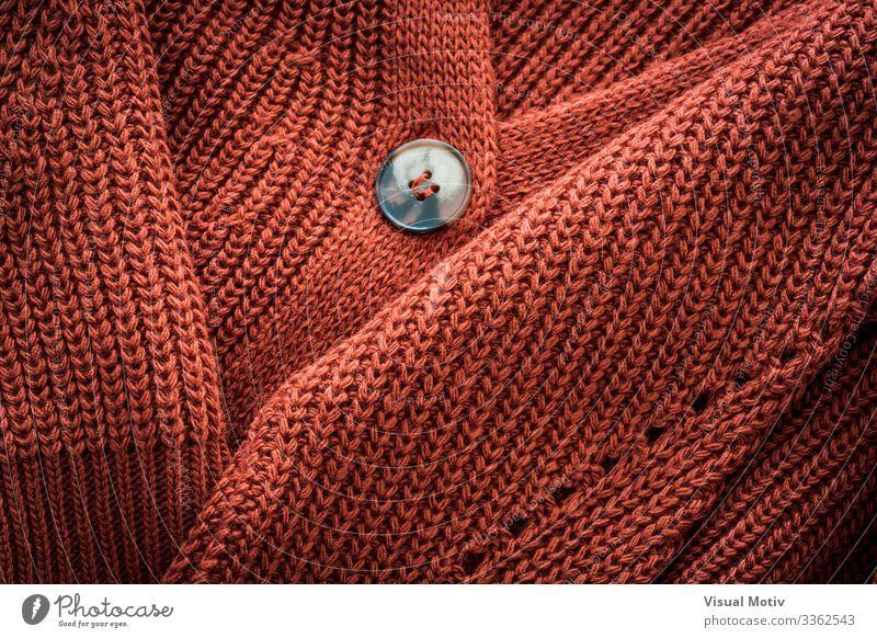 Strickjacke aus Naturwolle Design Winter Industrie Mode Bekleidung dick natürlich rot Geborgenheit bequem Farbe texturiert Hintergrund Oberfläche Strickwaren