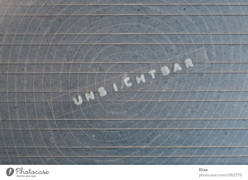 Unsichtbar Schriftzeichen blau silber Text unsichtbar dezent angepasst subtil tape Etikett Linie Schüchternheit Farbfoto Außenaufnahme Studioaufnahme