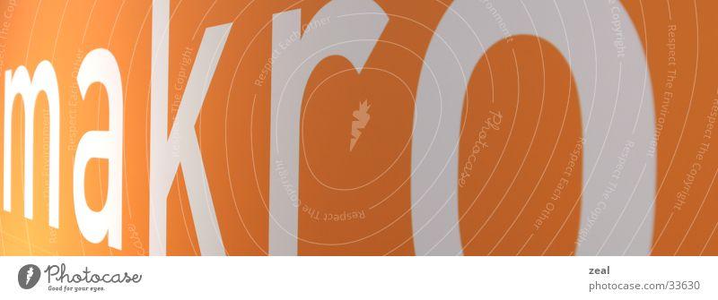 makro letters orange stehen nah Schriftzeichen Buchstaben Fototechnik Werbeschild
