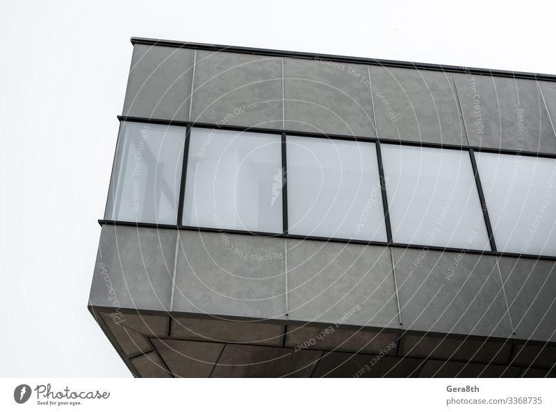 Fragment eines betongrauen Gebäudes mit leeren Fenstern Haus Büro Hochhaus Architektur Straße Stein Beton modern neu trist Gebäudewinkel Appartements Großstadt