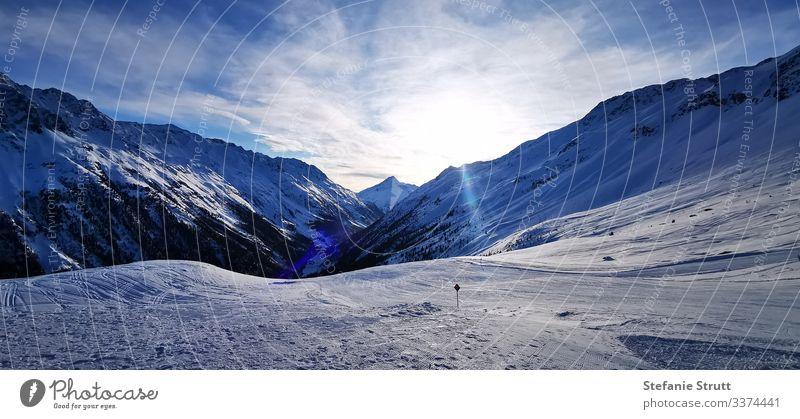 Pistenparadies im Sonnenuntergang Panorama (Aussicht) Licht Menschenleer Bewegung Ferne Schneebedeckte Gipfel Berge u. Gebirge Natur Landschaft Himmel Alpen
