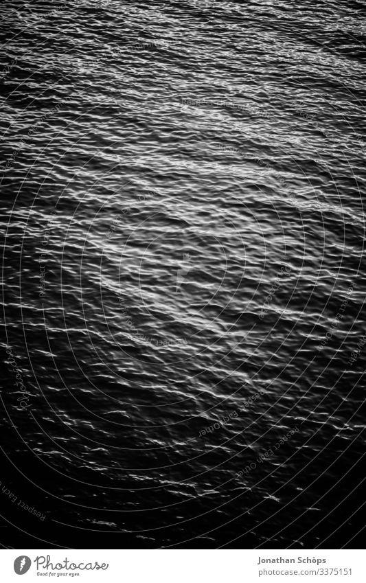 Minimale schwarze Textur des Hintergrundwassers Abstrakter schwarzer Hintergrund Schwarze Textur Minimales Schwarz Minimalismus Minimalistisches Schwarz