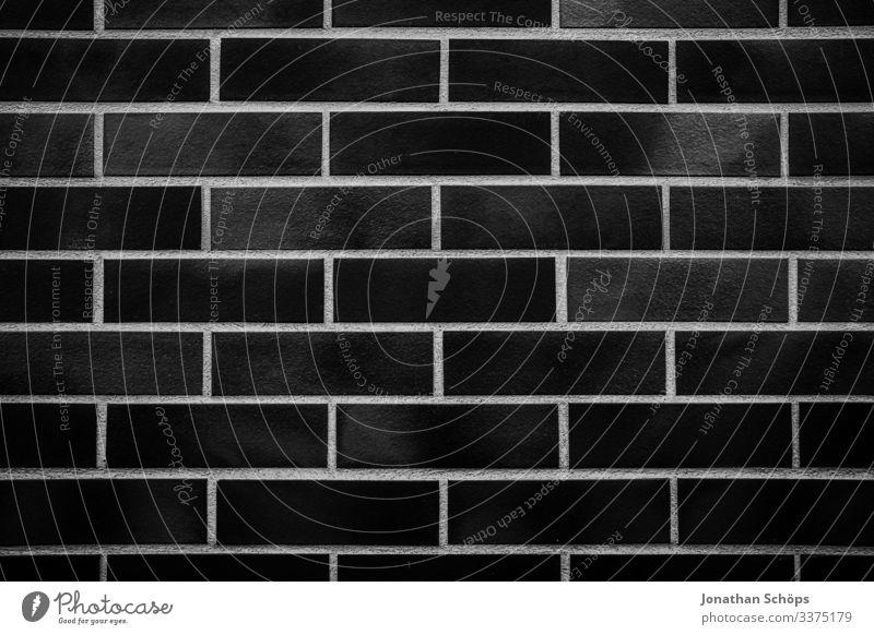 Minimale schwarze Textur des Ziegelwandhintergrunds Abstrakter schwarzer Hintergrund Schwarze Textur Minimales Schwarz Minimalismus Minimalistisches Schwarz
