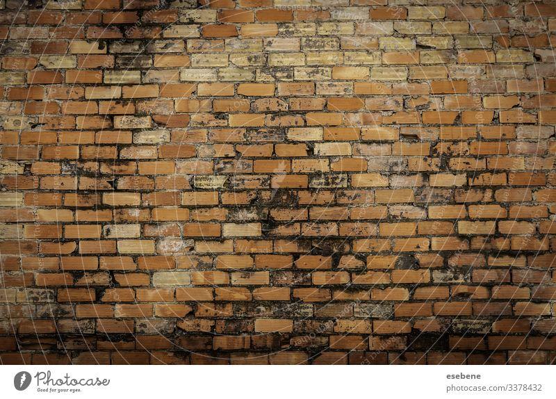 """Alte Lehmziegelmauer verbrannt dreckig Beton Zement im Freien Erde Detailaufnahme Hintergrund heimwärts Haus Struktur """"schlechtes Mauerwerk"""" """"Steinstruktur""""."""