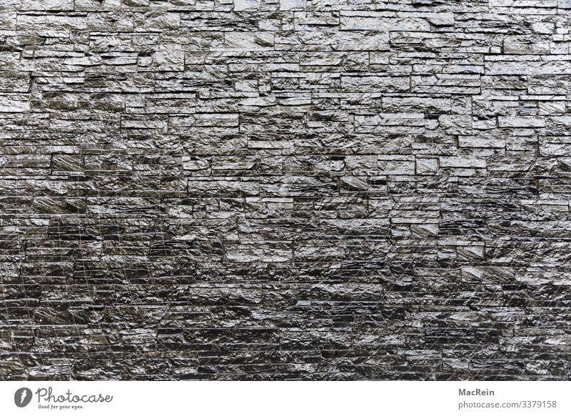 Graue Klinker Mauer Wand Fassade Terrasse Garten Stein dunkel eckig glänzend modern grau Design Backstein Fuge Muster Strukturen & Formen Aussehen Farbfoto