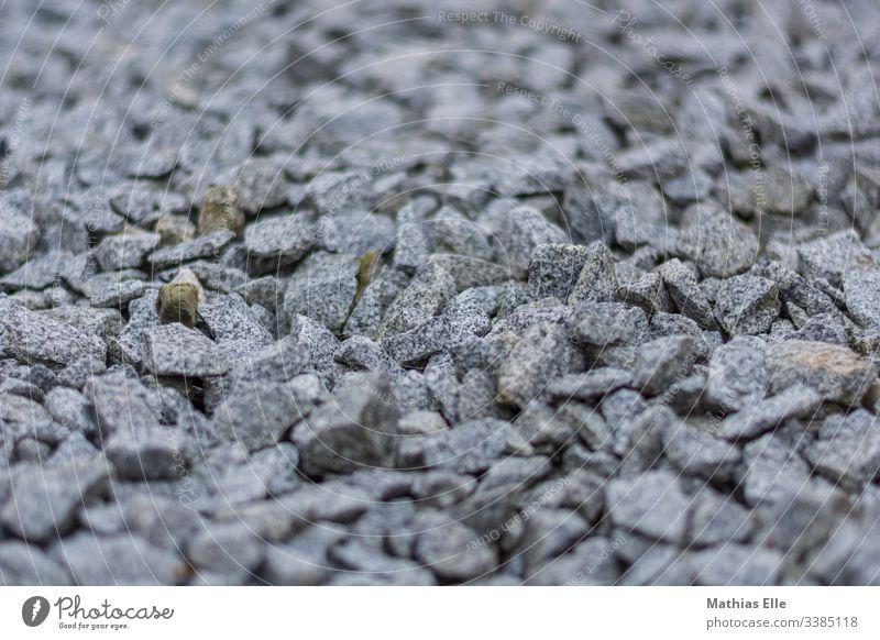 Grauer Schotter steine Farbfoto Außenaufnahme Menschenleer Felsen Kieselsteine Stein klein blanko Hintergrund Baustoff Konsistenz Strand Schwarzweißfoto