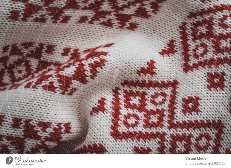 Detail der skandinavischen roten Motive Industrie texturiert Strickjacke Mode Hintergrund Oberfläche Design abstrakt Textur Nahaufnahme niemand Detailaufnahme