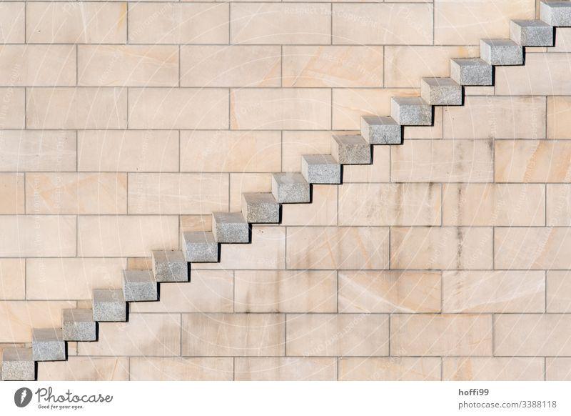 Diagonale Stufen mit Sandstein Mauer diagonal Wand Baustein minimalistisch Stufenordnung stufen Treppe Treppenansatz Steinwand Ordnung Linien Muster