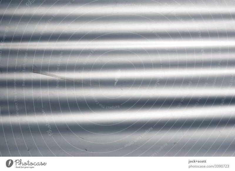gewellte, graue und glatte Fläche Oberfläche abstrakt Hintergrundbild Strukturen & Formen Detailaufnahme Hintergrund neutral Plane Kunststoff Schatten