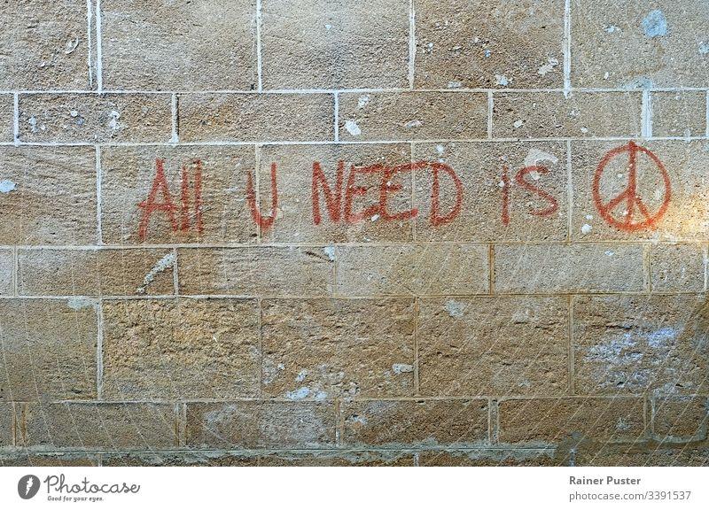 Graffiti an einer Wand: All U Need Is Peace Friede frieden friedensbewegung symbol Street Art streetart friedenszeichen