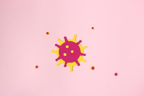 Corona Virus Illustration Coronavirus Papier Nahaufnahme abstrakt Bakterien Hintergrund rosa Medizin Forschung Wissenschaft Gesundheitswesen Labor Farbfoto
