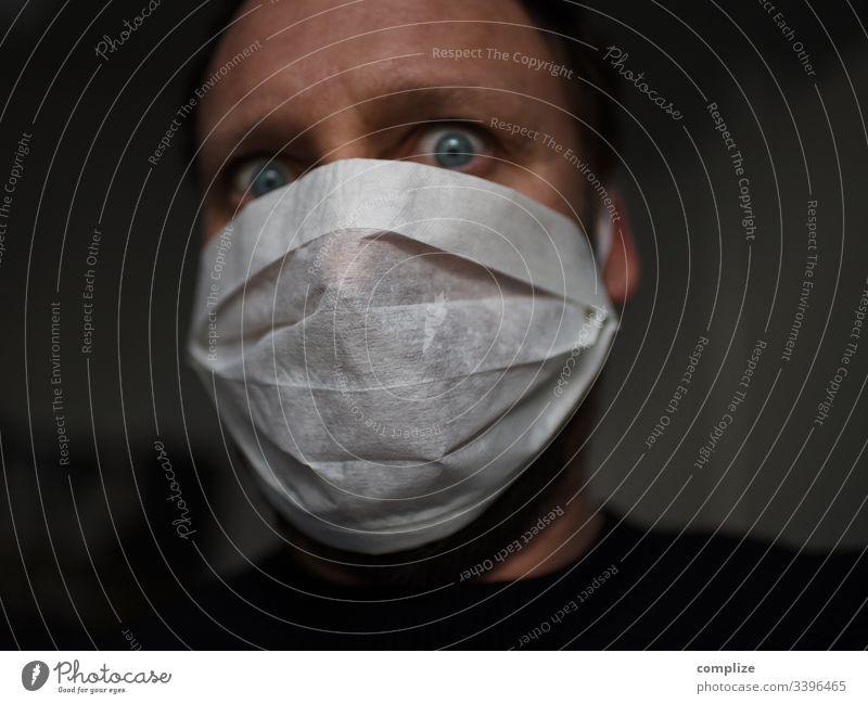 Angst vor dem Virus | Mann mit Mundschutz Corona virus coronavirus grippe mundschutz medizin influenza grippevirus ansteckung gefahr epedemi Epidemie