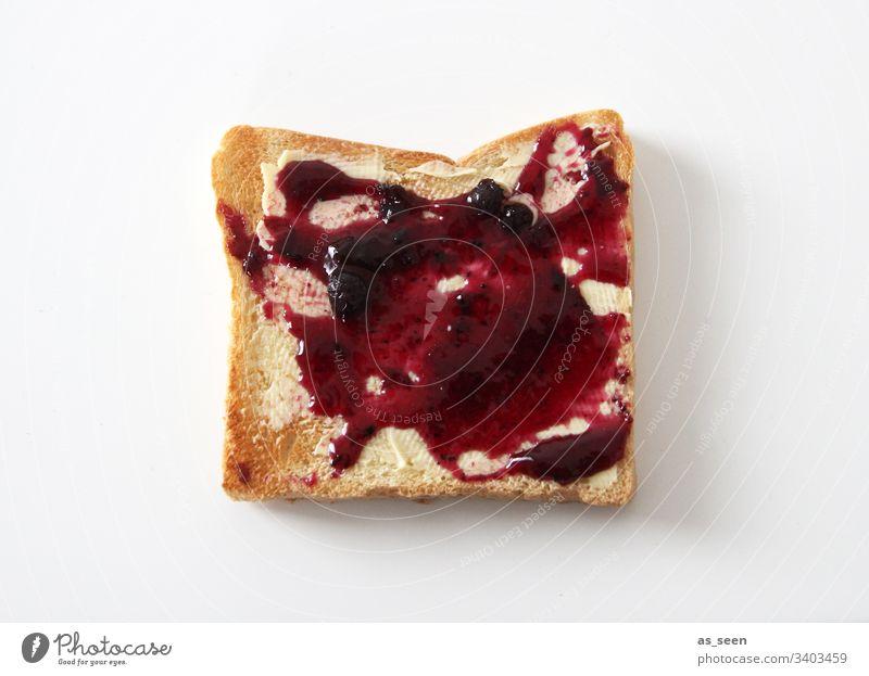 Toastbrot mit Marmelade Scheibe Lebensmittel Frühstück Ernährung Brot Farbfoto lecker Innenaufnahme Menschenleer Vegetarische Ernährung Tag Nahaufnahme