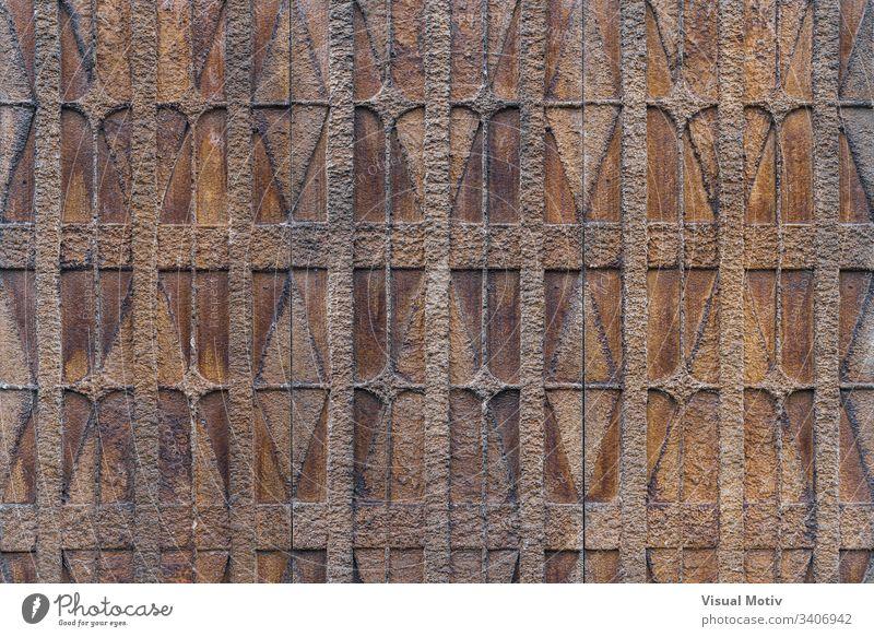 Texturierter Hintergrund eines dekorativen geometrischen Motivs an einer Wand Farbe Architektur architektonisch menschengemacht keine Menschen niemand Struktur