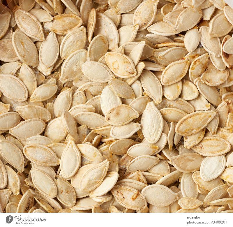 trockene, rohe Kürbiskerne, Vollrahmen Lebensmittel Gesundheit Samen Vegetarier Hintergrund organisch Gemüse frisch Diät weiß Mahlzeit Ernährung natürlich gelb