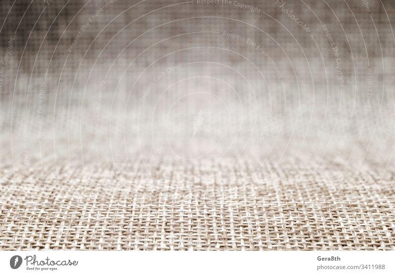 leeres Hintergrundmuster raue Stoffmattierung in Unschärfe abstrakt Bast blanko verschwommen braun schließen abschließen Farbe Design Fußmatte Gewebe Sehne grau