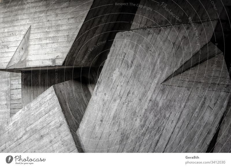 Fragment einer grauen Betonwand Abstraktion Winkel Architektur Hintergrund schwarz blanko Blöcke Gebäude Kurve dunkel Design trist Haus Licht Linie modern