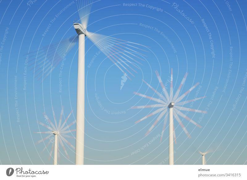 vier unterschiedlich weit entfernte Windräder mit Mehrfachbelichtung Windrad drehung energie windkraft drehen Physik enrgieerzeugung windenergie blau himmel