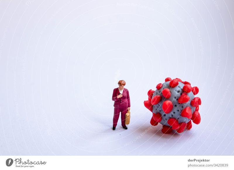Angela Merkel und der Corona-Virus sars Lungenentzündung Maske Schützen Epidemie Impfstoff Gesundheitswesen Krankenhaus Fieber covid-19 COVID Gefahr Ausbruch