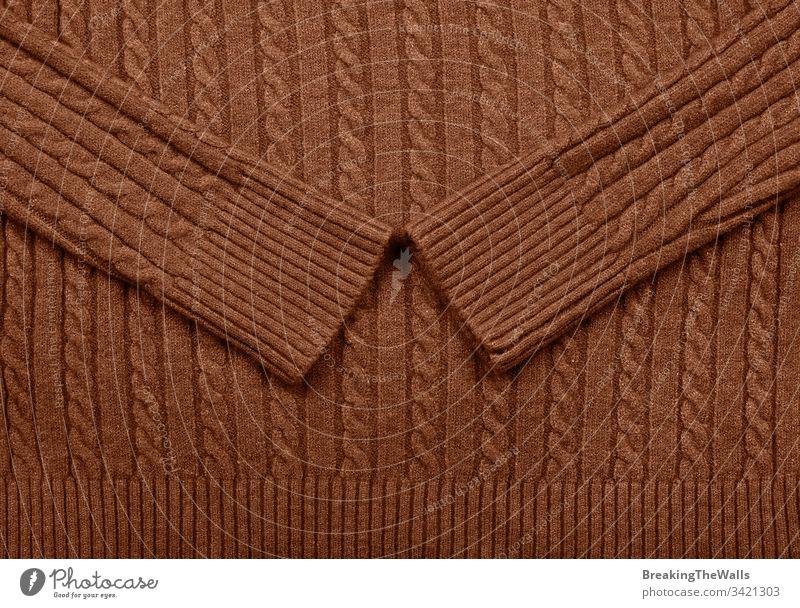 Hintergrundtextur aus braunem Wollgestrick Strickwaren dunkel lebhaft Textur Muster Gewebe Wolle Kabel stricken Pullover Geflecht gestrickt Trikot Strumpfwaren