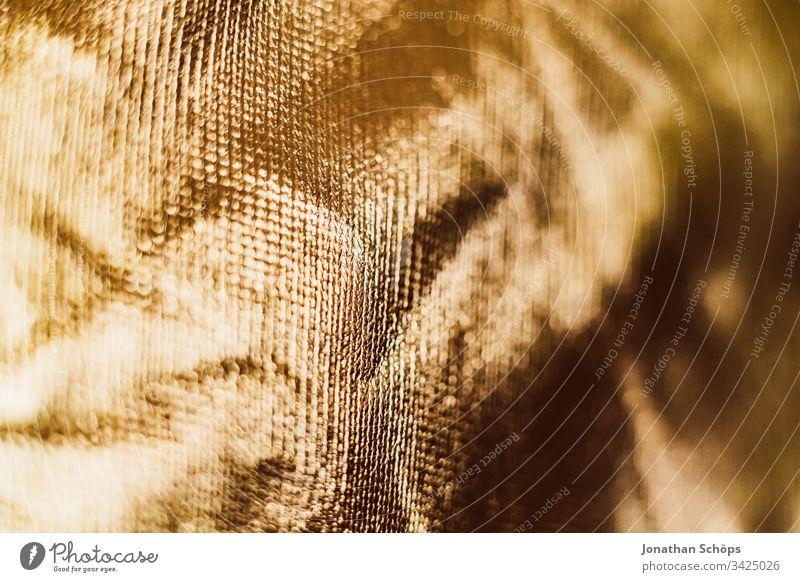 Textur der glänzenden Goldhintergrundfolie Hintergrund hell abschließen Folie glamourös eklatant gold golden Material perlmuttartig Fotografische Ausrüstung