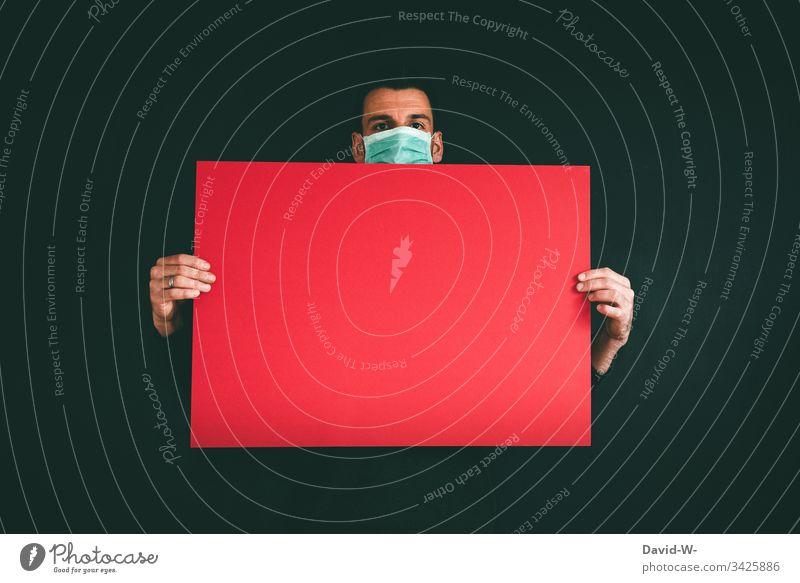 Coronavirus Hinweisschild Atemschutzmaske Mann Achtung Gefahr Virus Mundschutz Schützen hinweisend Infektion Gesundheit Infektionsgefahr Ansteckend Angst Seuche