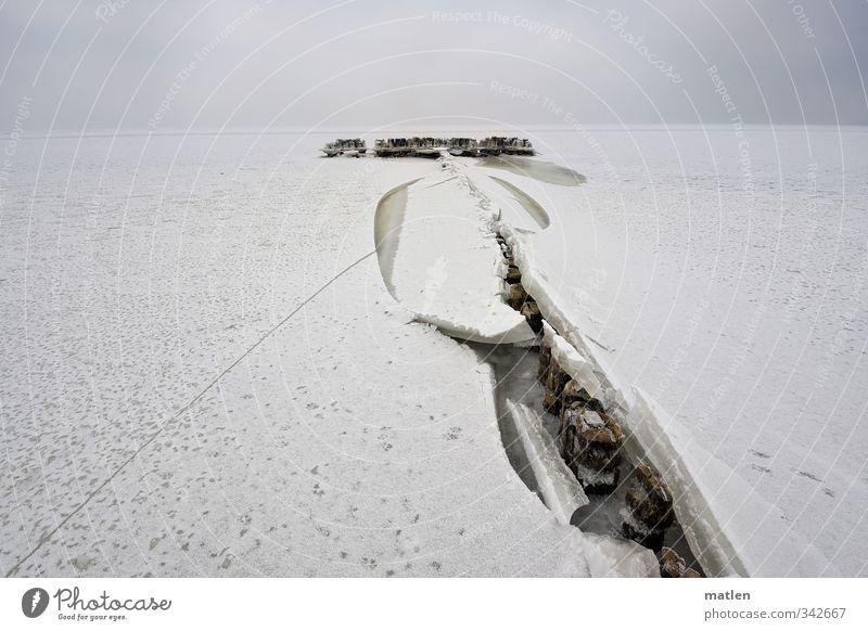das Gerücht Himmel weiß Meer Landschaft Wolken Strand Winter Schnee Küste braun Wetter Klima schlechtes Wetter Holzpfahl