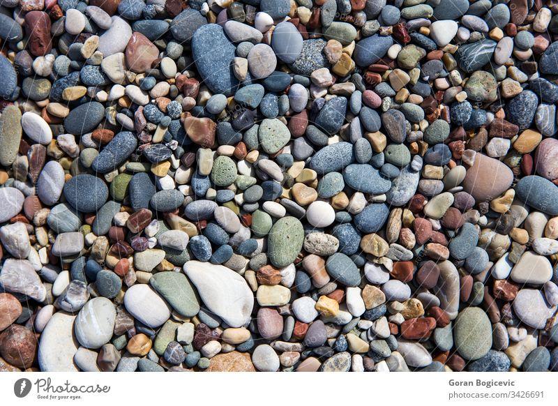 Nahaufnahme der Kieselsteine am Strand Hintergrund Natur Sommer Stein Textur sanft Küste Felsen Oberfläche abstrakt Material Seeküste trocknen Haufen farbenfroh