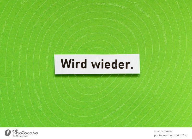 """Optimistischer Schriftzug """"Wird wieder"""" vor grünem Hintergrund Optimismus Farbfoto Hoffnung Glück positiv Lebensfreude Gefühle Freude Schriftzeichen"""