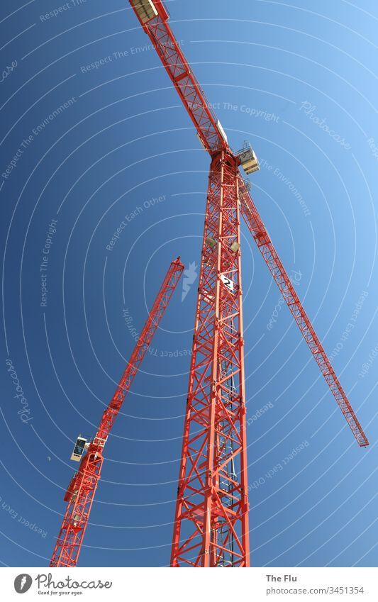 Baukran Baugewerbe Kran Baustelle Himmel bauen Außenaufnahme Farbfoto blau Tag Arbeit & Erwerbstätigkeit Industrie Handwerk Stahl hoch Technik & Technologie
