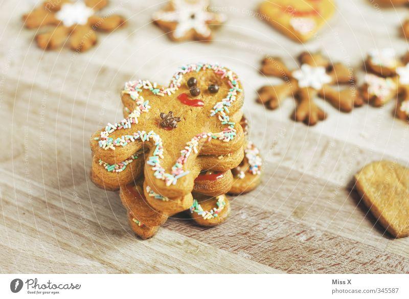 Lebkuchenmännchen Lebensmittel Teigwaren Backwaren Süßwaren Schokolade Ernährung lecker süß Plätzchen Weihnachtsgebäck Männchen Weihnachtsdekoration Farbfoto