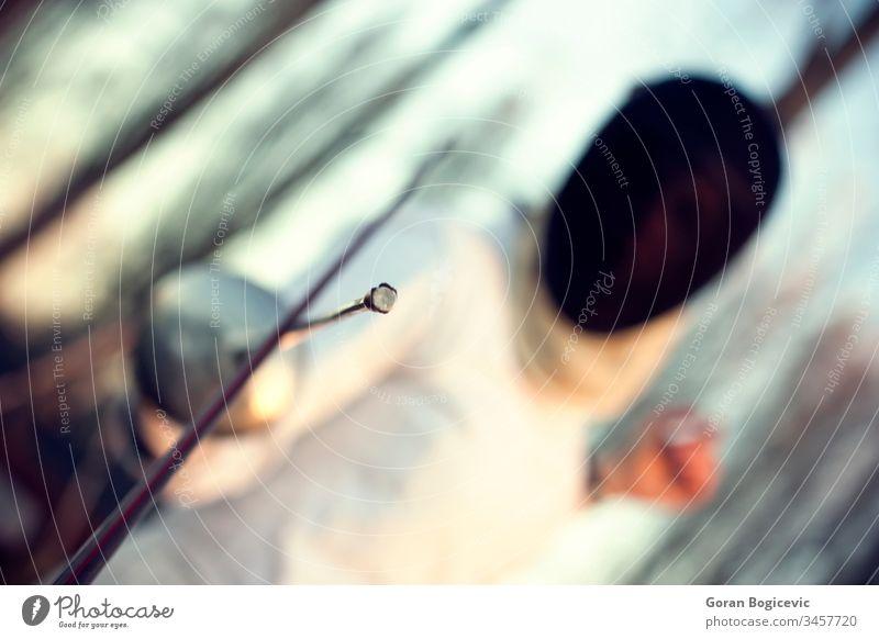 Fechten Zaun Athlet Sportler sportlich Hintergrund schwarz schließen Bekleidung Konkurrenz dramatisch kämpfen Kopf Beleuchtung Blick männlich Mann Mundschutz