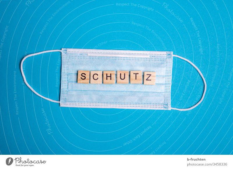 Schutzmaske auf blauem Hintergrund Maske coronavirus Mundschutz Gesundheit Seuche Grippe Infektion Medizin Infektionsgefahr Prävention Coronavirus Krankheit