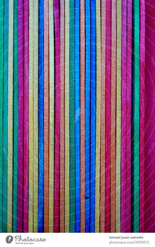 bunte Holzstäbchen, mehrfarbiger Hintergrund kleben Essstäbchen hölzern Farben farbenfroh dekorativ Dekoration & Verzierung verziert texturiert abstrakt Objekt
