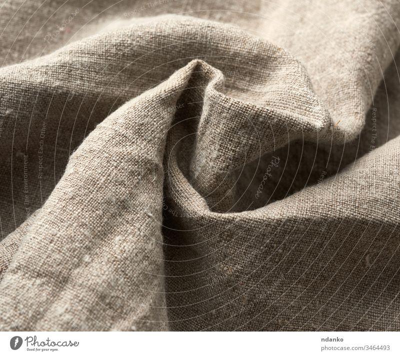 gezwirntes sehr altes graues Leinengewebe, Vollrahmen, raue antike Leinwand abstrakt Hintergrund blanko Sauberkeit Nahaufnahme Stoff Bekleidung Farbe Baumwolle