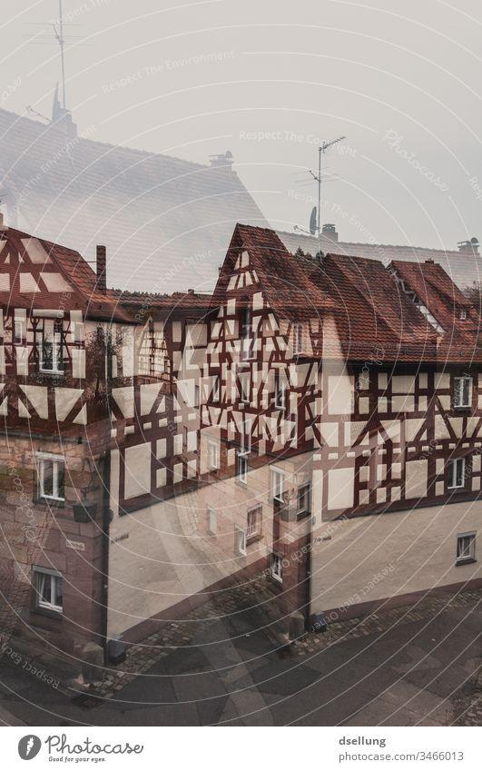 Doppelbelichtung einer Straße mit Fachwerkhäusern Realitätsflucht wirklich träumen Ferien & Urlaub & Reisen Tourismus verkehrt Luftschloss nachhaltig