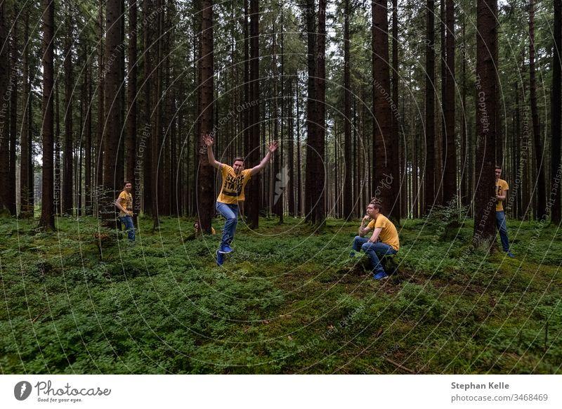 Fun in a forest, multiple selfie in different poses. Selfie tree nature photoshop green fun hide jump person man men same Farbfoto Außenaufnahme landscape wood