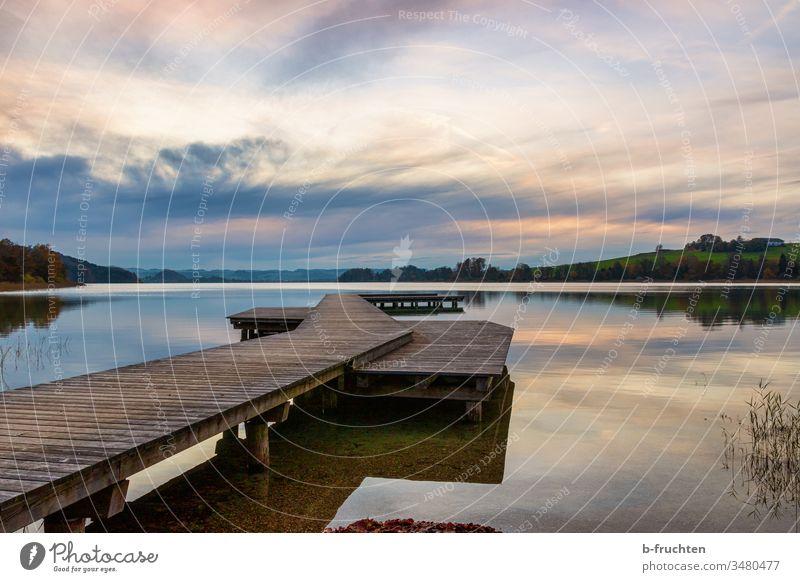 Abendstimmung am See, Holzsteg, Wolken wolken Stimmung Mattsee Sonnenuntergang Himmel Natur Landschaft Dämmerung Außenaufnahme Menschenleer Umwelt Wasser