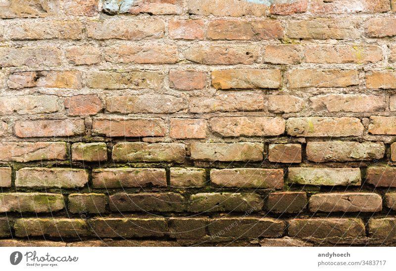 Alte Sandsteinmauer mit Moos abstrakt gealtert Architektur Hintergrund Tafel Holzplatte Baustein Mauerwerk braun bauen Zement Konstruktion Design Detailaufnahme