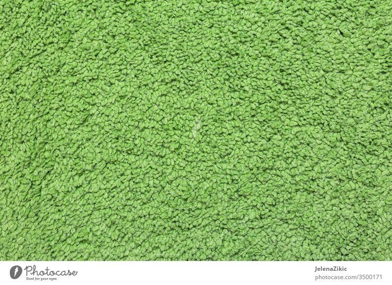 Grünes Wollmuster Bekleidung Stoff Herbst Material Sehne Wollstoff Wolle Muster texturiert Handwerk Struktur handgefertigt Textur Farbe Element warm Makro Mode