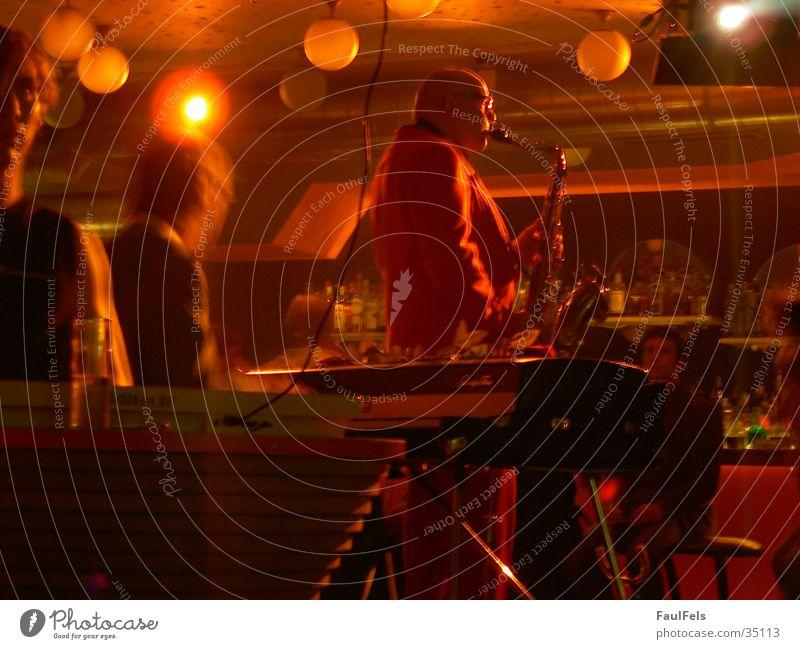 Play that funky music Bar Saxophon Licht Konzert Club orange Musik